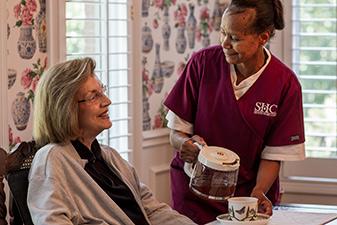 Around-the-clock, 24/7 Seniors Home Care caregiver helping a client