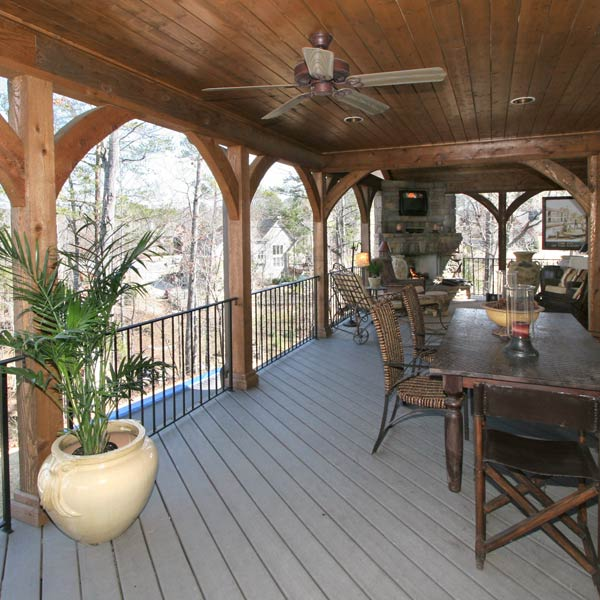 Handsome Hand Carved Arches Grace The Exterior Frame Of This Beautiful Covered Deck Porch
