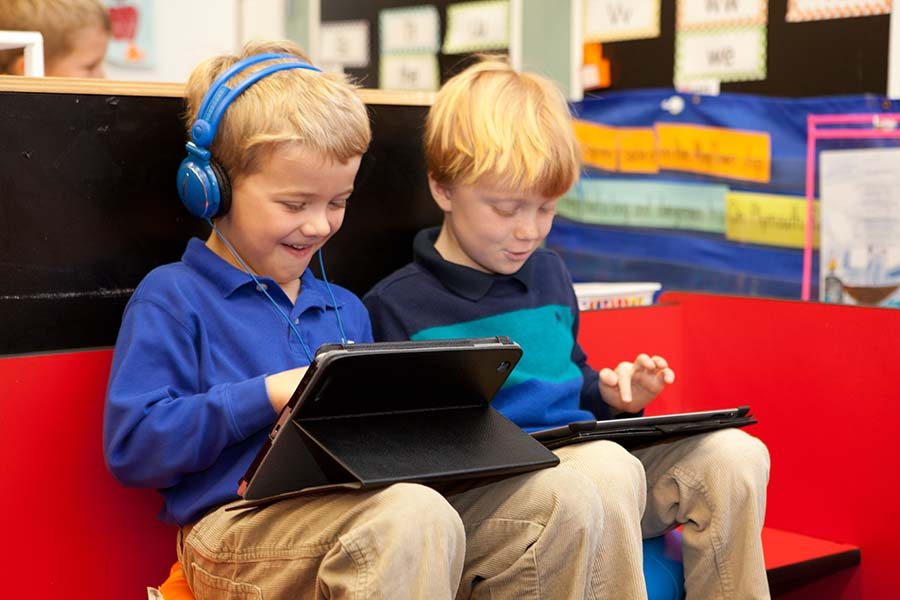 Lower School students use iPads to enhance learning.