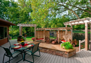 This First Outdoor Living Space Includes A Deck, Patio And A Multilevel  Pergola. While Itu0027s Pretty Open, The Different Structures Serve Different  Purposes.