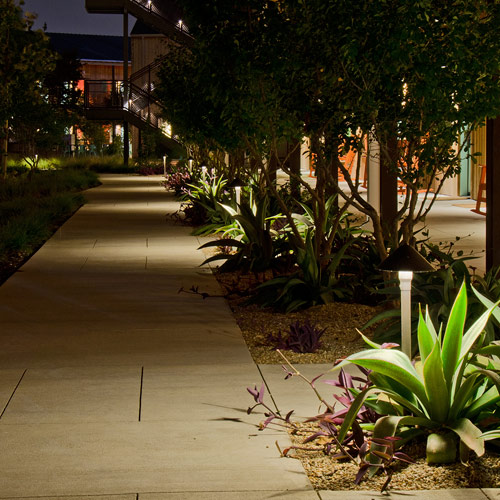 The beautiful thing about Outdoor Lighting Perspectives path way lighting is that it provides a clear sightline for guests and team members traversing your outdoor areas after dusk while casting luminescent glows of surrounding landscapes and shrubbery. In this design plan Sarasota Stake Mounted Path Lights, Triton and Key West outdoor path light fixtures were blended throughout the landscape to create interest and dimension. Spaced appropriately to create interesting shadow patterns, as well as effectively illuminate the walkways, these Outdoor Lighting Perspectives fixtures also provide interesting light patterns to highlight ornamental objects placed in the mulch beds.