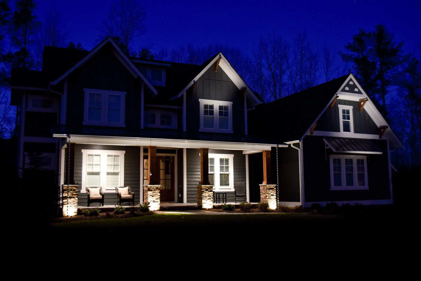 A poorly lit home in need of outdoor lighting service.