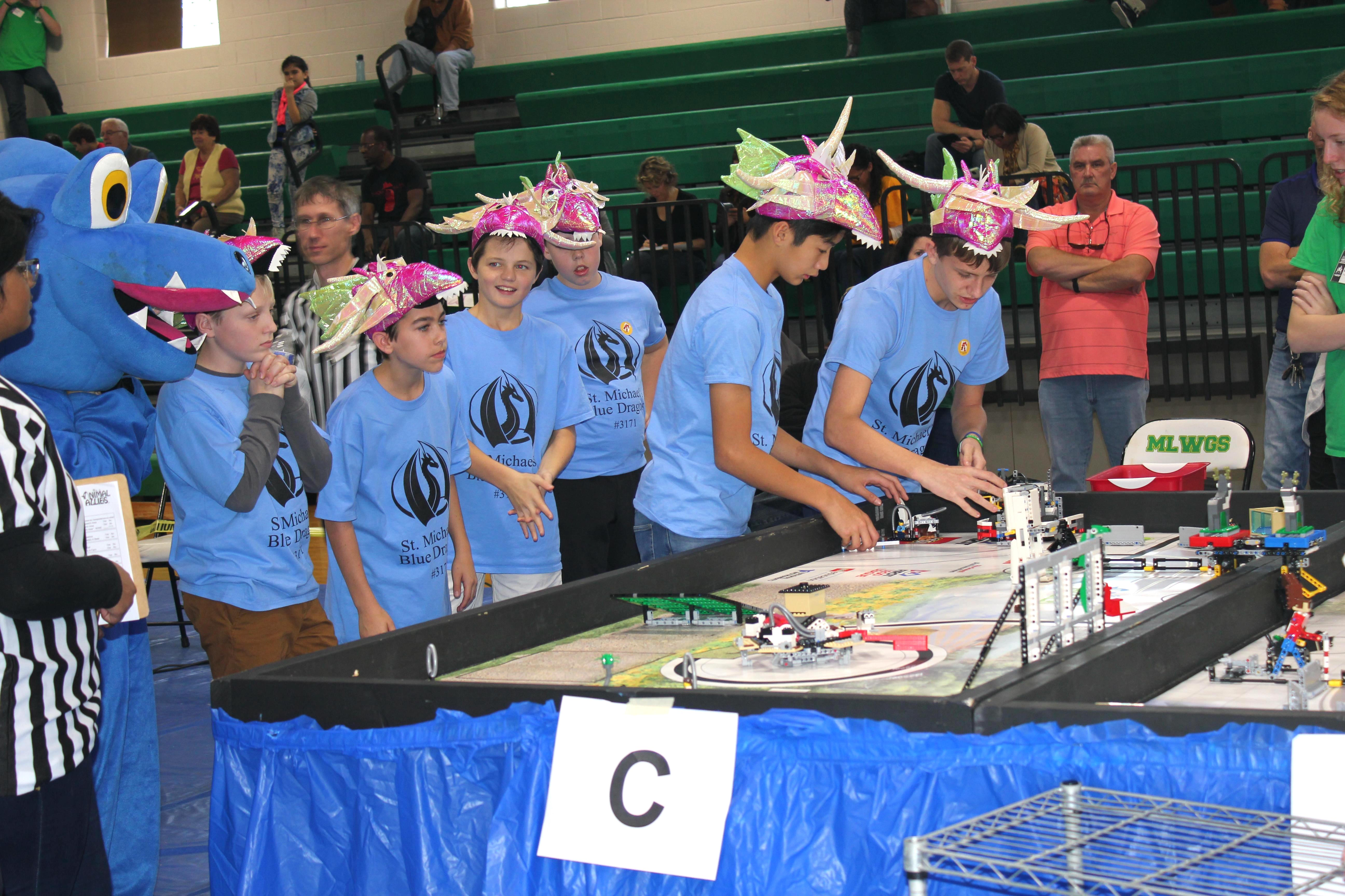 St. Michael's students engaged in a FIRST LEGO League robotics competition.
