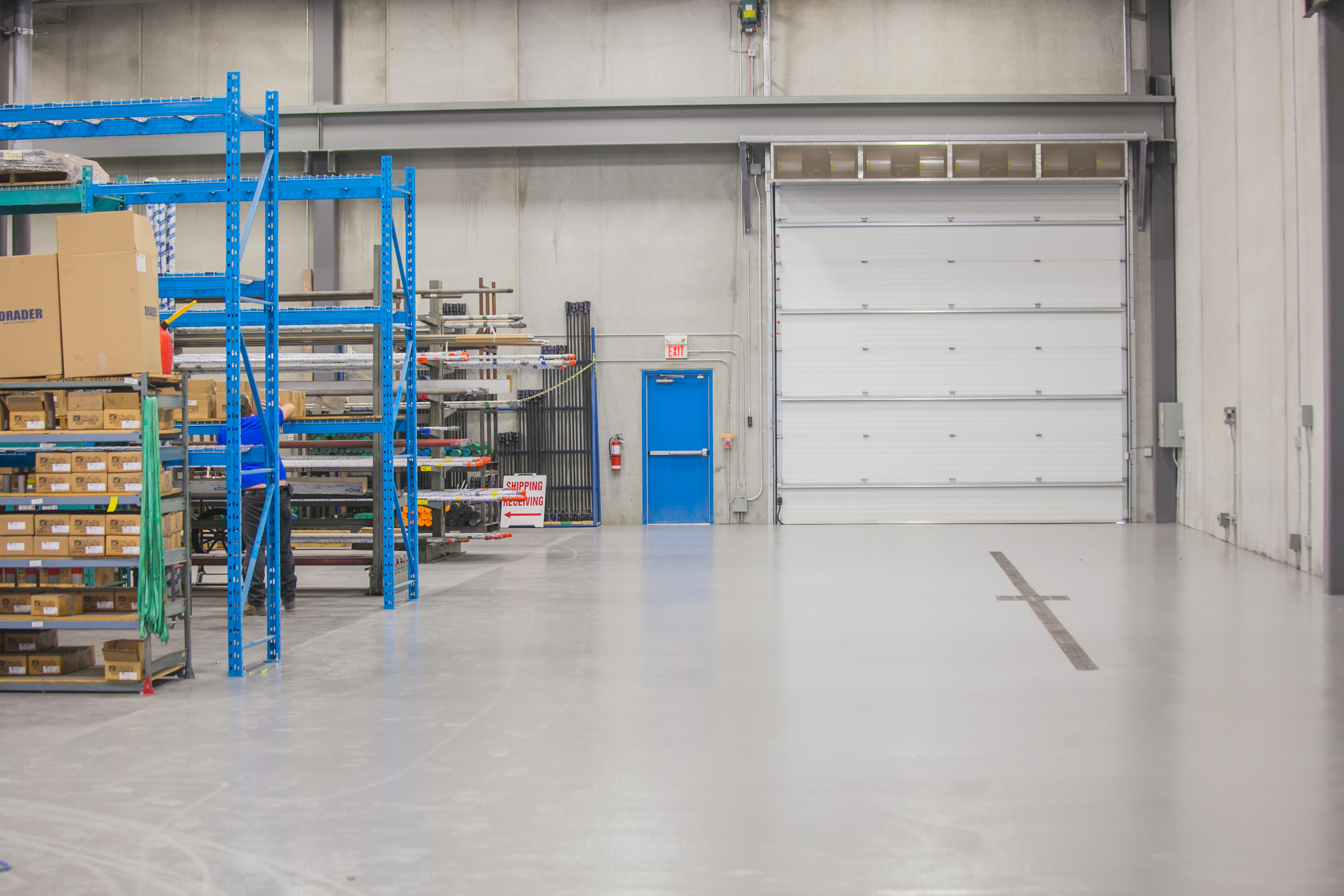 Edmonton Concrete Epoxy Floor Coatings with a High Wear Urethane Top Coat in an Industrial Oilfield Supply Company's Warehouse